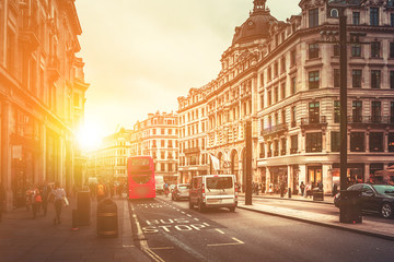 Oxford Street in London against golden sun ray while after work