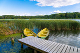 Boats on wooden jetty in a lake - 228716374