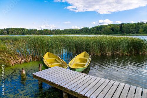 Acrylglas Pier Boats on wooden jetty in a lake