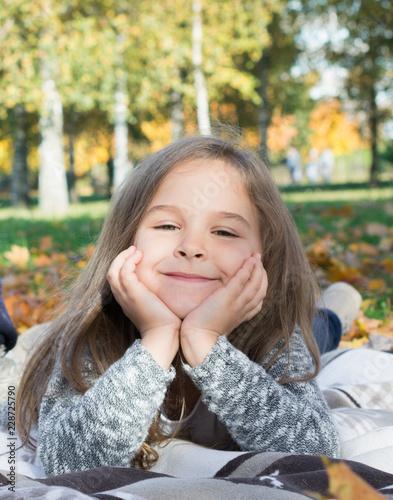 Autumn park: portrait beautiful little girl - 228725790