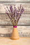 bouquet of lavender in a vase on a wooden background. Dried lavender. Copy space