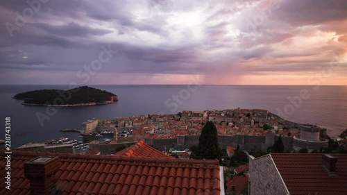 Time Lapse of clouds moving over old town during sunset, Dubrovnik, Croatia