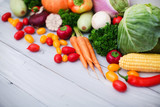 Heap of fresh vegetables on wooden background. - 228746335