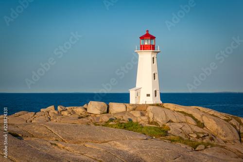 Leinwanddruck Bild View of Peggy's Cove lighthouse at sunrise, Nova Scotia, Canada