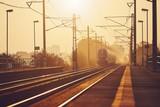 Passenger train at sunrise.