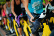 People training at a gym doing cyclo indoor. - 228833713