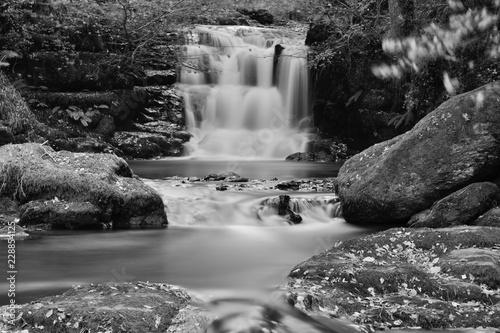 Long  exposure of the waterfall at Watersmeet in Devon - 228854125