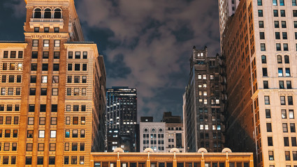 Clouds pass over Chicago skyscrapers at night