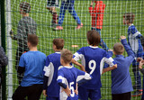young soccer players support their team