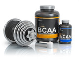 BCAA  branched-chain amino acid with scoop and dumbbell.Bodybuilder nutrition(supplement) concept. - 228878905