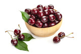ripe juicy cherry berries with leaves in a plate