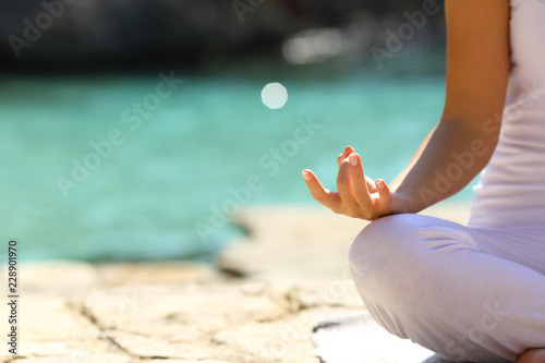 Sticker Woman practicing yoga exercises on the beach