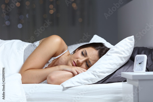 Leinwanddruck Bild Worried woman can not sleep in the bed at home