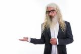 Studio shot of senior bearded businessman showing something - 228918532