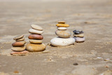 stones in the sand on the beach - 228921371
