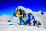 Skitouring with amazing view of swiss famous mountains in beautiful winter powder snow of Alps. - 228942917