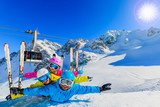 Happy family enjoying winter vacations in mountains . Ski, Sun, Snow and fun. - 228944789