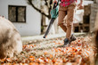 Leinwanddruck Bild - Portrait of male using leaf blower, close up details of gardening