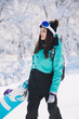 Woman snowboarder portrait at snowy day