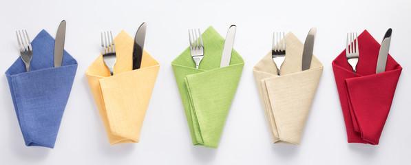 knife and fork in folded napkin © Sergii Moscaliuk