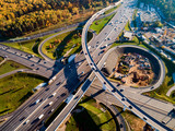 Aerial view of a freeway intersection traffic trails in Moscow. - 228961583