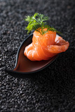 Salted salmon with dill on the background of black sesame. - 228962594