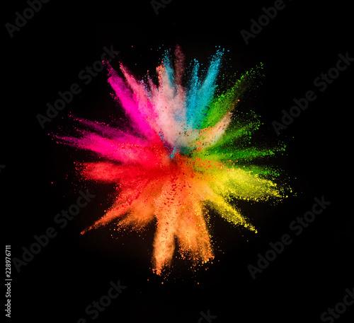 Leinwanddruck Bild Colored powder explosion on black background