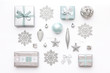 Beautiful christmas gifts and silver snowflakes and ornaments isolated on white background. Pastel blue colored wrapped xmas boxes. Christmas composition.