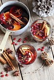 Mulled wine,punch,bowle oder spiced tea : winter traditional warming drinks with spicy,citrus fruits and pomegranate . Rustic style. - 228982177