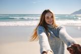 Woman enjoying with boyfriend at the beach - 228984539