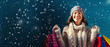 Leinwanddruck Bild - Happy young woman holding shopping bags in a snowy night
