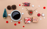 Christmas ornaments with coffee cup on a light brown paper background