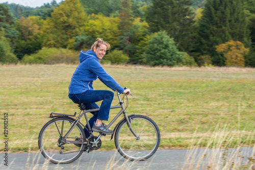 Dutch woman cycling on mountain bike © benschonewille