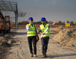 Enginers talking at building site
