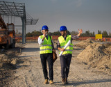 Enginers talking at building site - 229015951