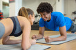 Handsome young couple working out at the gym