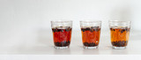 cascara coffee cherry tea in glass on white table background, eco-friendly unique drink