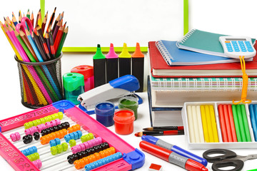 Assortment of school and office supplies isolated on white background.