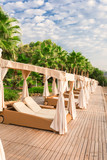 Premium private gazebo with sofas, private sun beds and personalized service at the beach. Relaxation and luxury beach holidays