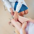 Leinwanddruck Bild - Neurological examination. The neurologist testing reflexes on a female patient using a hammer.