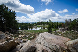 Alpine scenery with lake, trees, and rocks along the Beartooth Highway in Montana - 229044767
