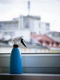 Spray bottle next to window