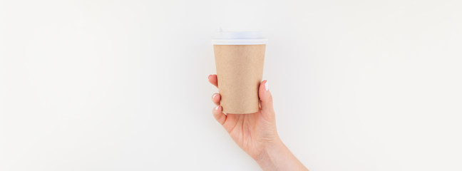 Mock up of coffee cup in female hand © dvoevnore
