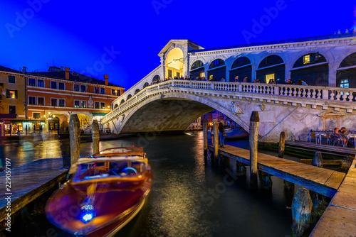 Leinwandbild Motiv Rialto bridge and Grand Canal in Venice, Italy. Night view of Venice Grand Canal. Architecture and landmarks of Venice. Venice postcard
