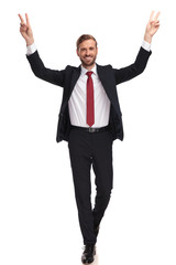 happy businessman walking and celebrating with hands in the air © Viorel Sima