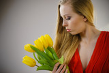 Lovely woman with yellow tulips bunch - 229065114
