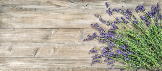 Lavender flowers rustic wooden background Vintage picture © LiliGraphie