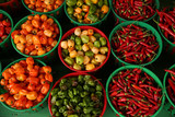 peppers of different colors in baskets on the market