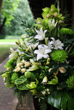 Bouquet with green orchids, roses and lilies