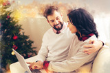 Hugging wife. Caring loving bearded husband hugging his beautiful wife on Christmas Eve spending evening together - 229103317